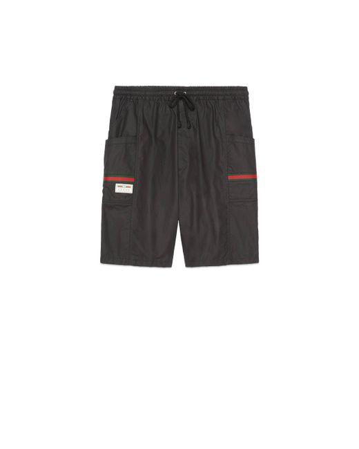 Short en coton enduit avec étiquette Gucci pour homme en coloris Black