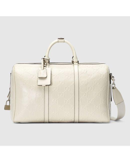 Gucci 【公式】 (グッチ)GGエンボス ダッフルバッグホワイト レザーホワイト Multicolor