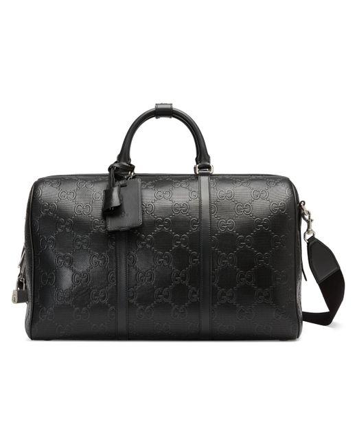 Gucci Black GG Embossed Duffle Bag for men