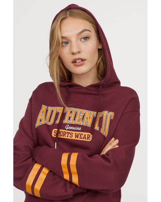 H&M - Red Printed Hooded Sweatshirt - Lyst