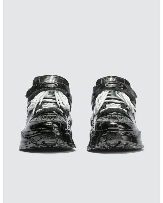 newest 992c0 1f679 ... Maison Margiela - Black Retro Low Fit Metallic Sneakers - Lyst ...