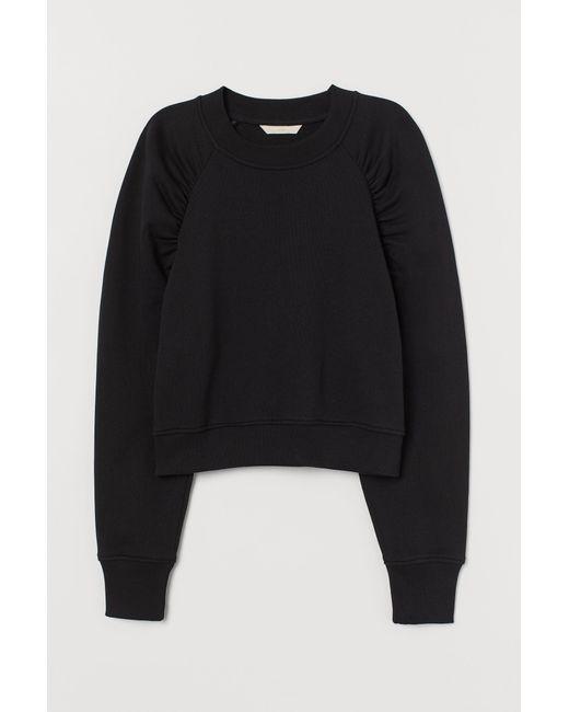 H&M Black Sweatshirt aus Baumwolle
