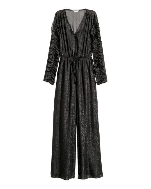 H&M Black Glitzernder Jumpsuit