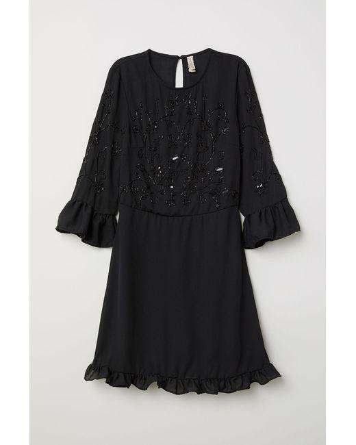 Robe avec perles fantaisie H&M en coloris Black