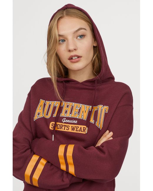 H&M - Red Printed Hooded Sweatshirt - Lyst