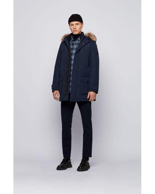 Manteau doudoune déperlant à finition amovible en fourrure synthétique BOSS by Hugo Boss pour homme en coloris Blue