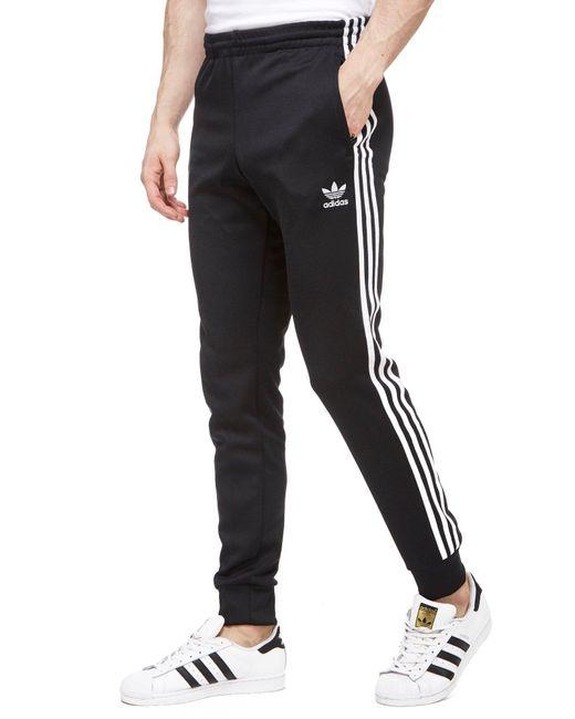 adidas originals super star cuff trousers in black for men. Black Bedroom Furniture Sets. Home Design Ideas