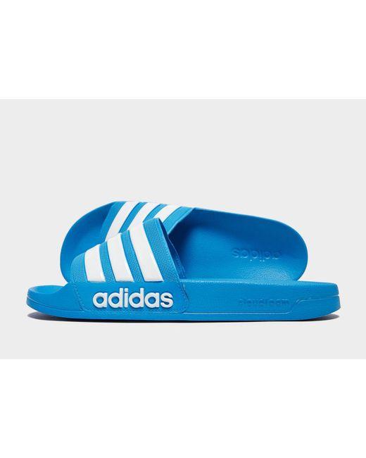 9ff6b3228dcbab Adidas Originals - Blue Adilette Cloudfoam Slides for Men - Lyst ...