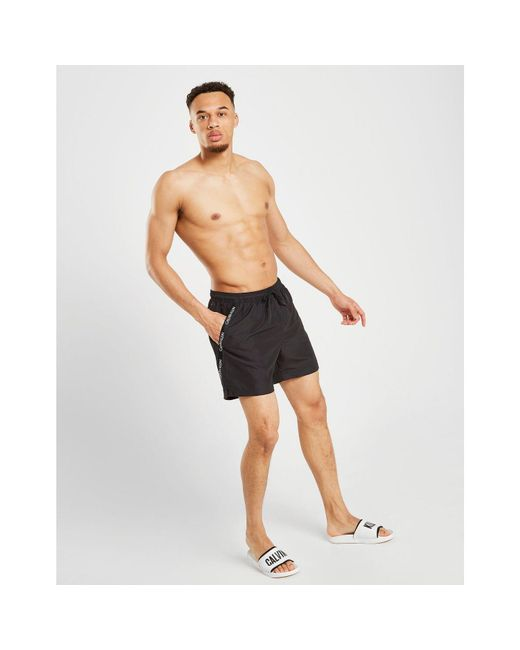 b413e947eb8 Calvin Klein - Brown Diagonal Tape Medium Swim Shorts for Men - Lyst ...