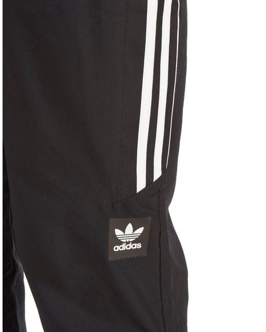 Adidas Originali Gli Tessuti Ammanettato Pantaloni Della Tuta Nera Per Gli Originali Uomini - 4 fa2d12