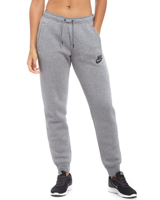 Lyst - Nike Rally Trousers in Grey