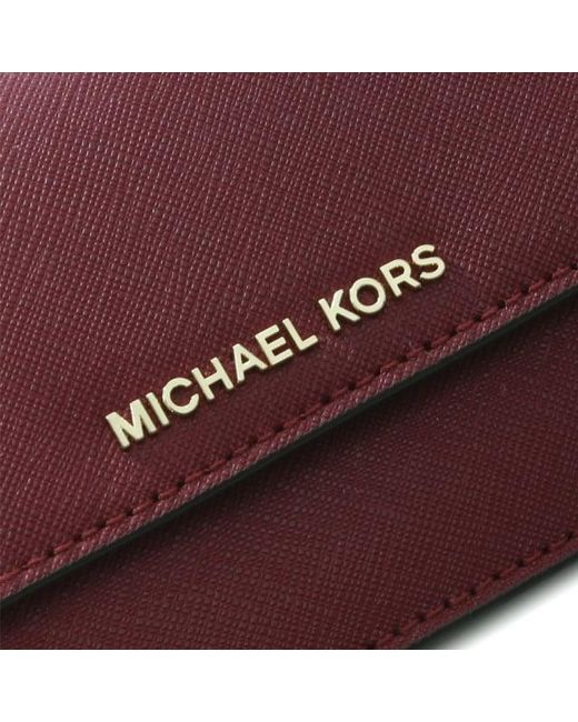 37a121e0841b Michael Kors Red Jet Set Travel Mulberry Saffiano Leather Slim Wallet Colo  Lyst ...