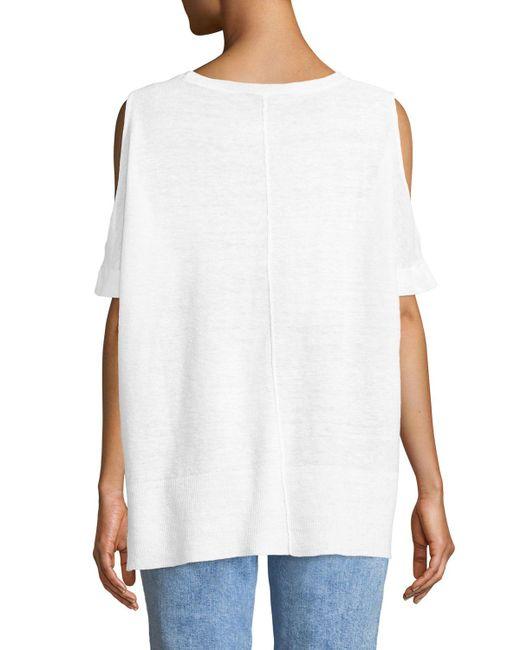 4bd56760885be6 Lyst - Donna Karan Cold-shoulder Grommet-hem Top in White - Save 63%