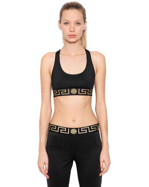 Versace - Black Logo Band Sports Bra - Lyst