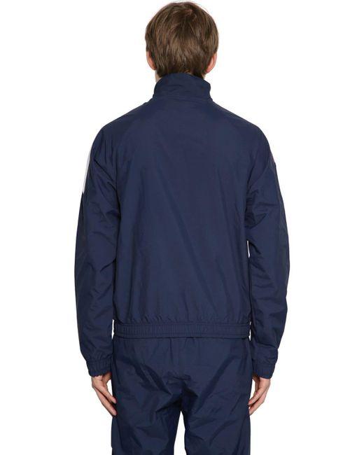 メンズ Reebok ナイロントラックジャケット Blue