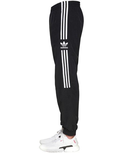 pantaloni a zampa adidas