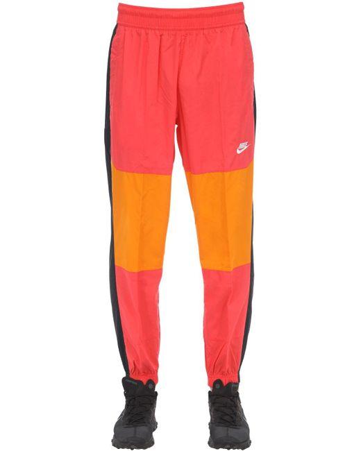 メンズ Nike ウーヴンテクノトラックパンツ Red