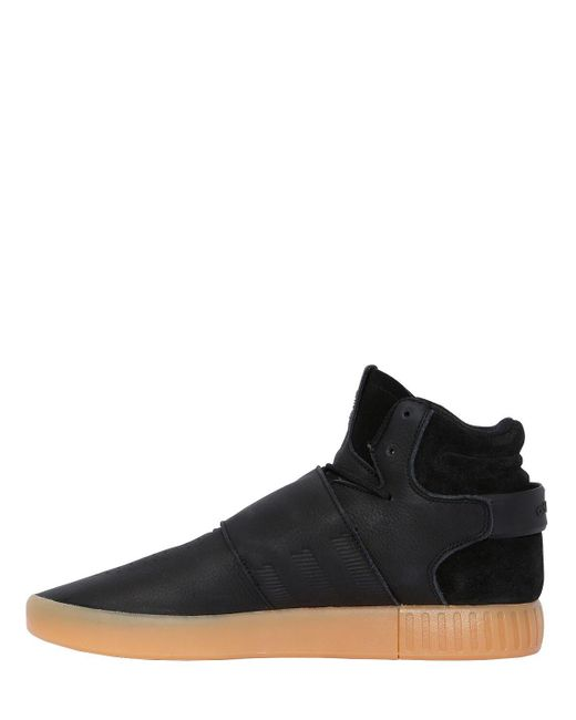 new styles ace17 b2032 Men's Black Tubular Invader Strap Mid Top Sneakers