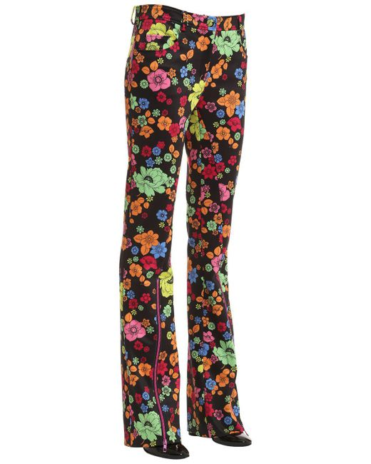 Moschino BOOT CUT FLORAL PRINTED INTERLOCK PANTS