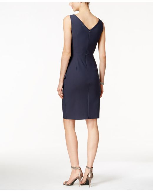 Give a glamorous update to your club outings and cocktail dinners by getting dressed in this ravishing sheath dress in charcoal. Designed in a body-hugging style, this spaghetti-sleeved dress features an endearing arrangement of ruched accents running throughout the dress.
