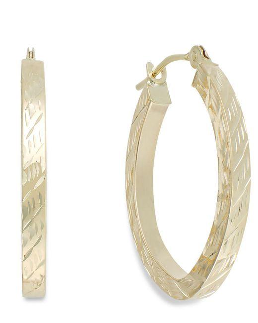 Macy's Metallic Textured Oval Hoop Earrings In 10k Gold