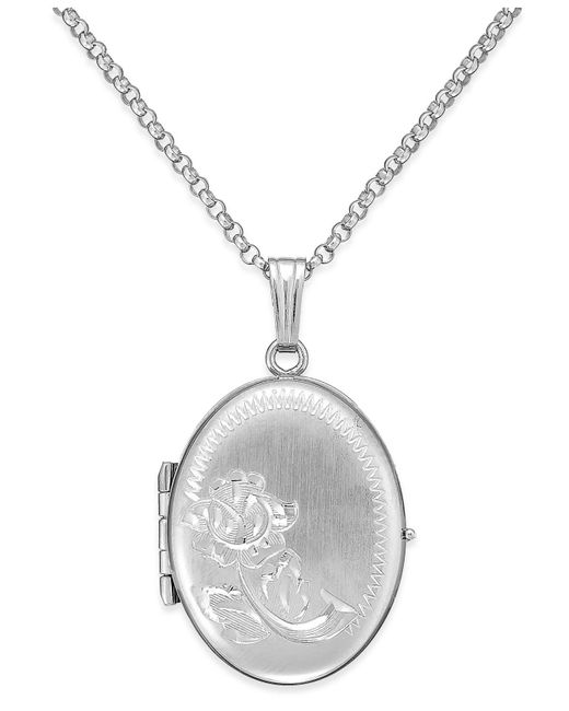 Macy's - Metallic Embossed Four-picture Oval Locket In Sterling Silver - Lyst