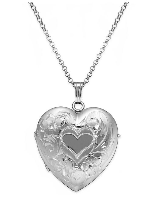 Macy's - Metallic Embossed Four-picture Heart Locket In Sterling Silver - Lyst