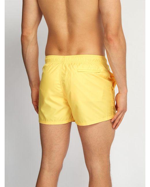 c373271ffa ... Givenchy - Yellow Logo Print Swim Shorts for Men - Lyst ...