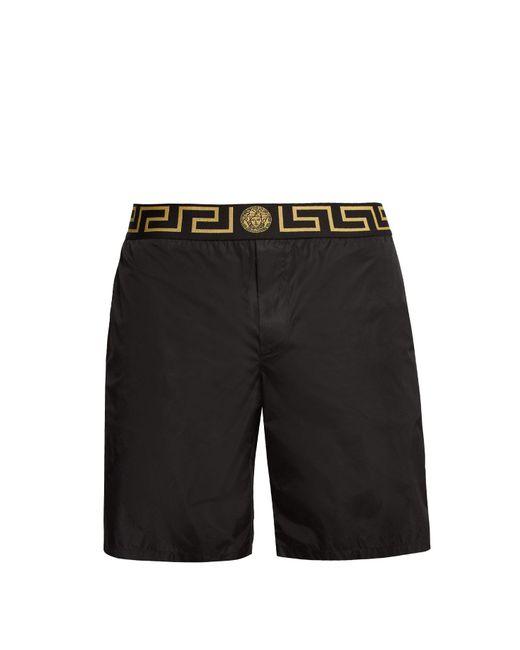 Versace Black Logo Jacquard Mid Rise Swim Shorts for men