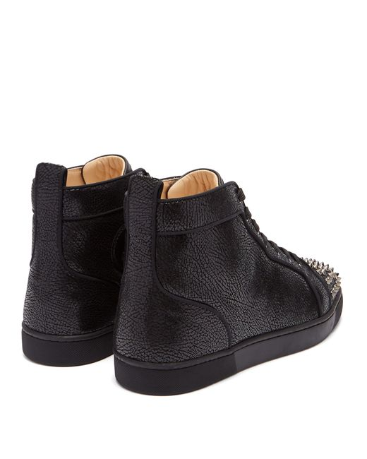 1242c40ee5a Christian Louboutin Lou Spike Embellished Leather High Top Trainers ...