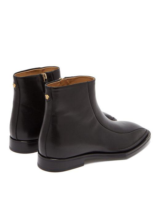 864f6f81943 Men's Black Medusa Embellished Leather Boots