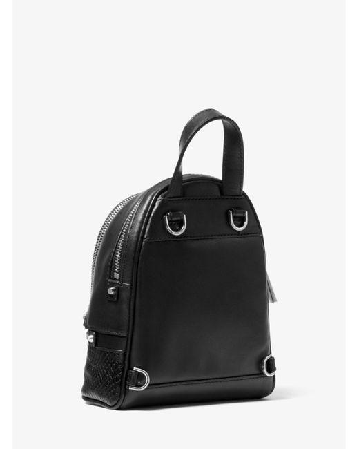 938f3fdee172 ... Michael Kors - Black Rhea Mini Python-embossed Leather Backpack - Lyst  ...