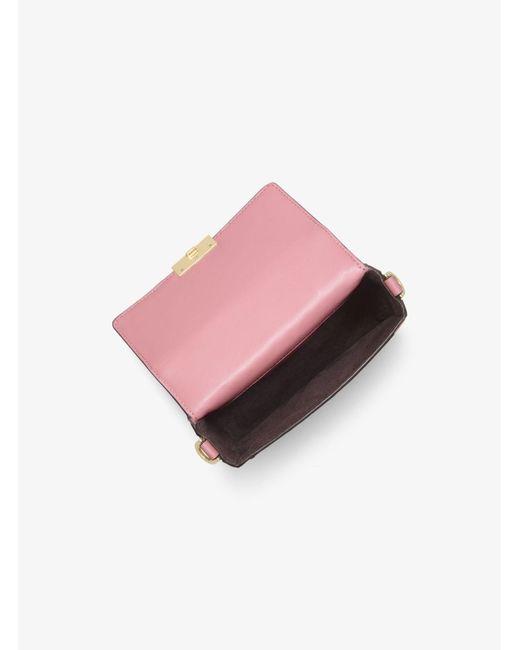 d41449b0499c ... MICHAEL Michael Kors - Pink Jayne Small Studded Leather Trunk Bag -  Lyst ...