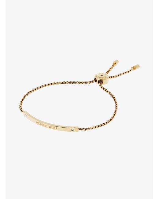Michael Kors - Metallic Logo Gold-tone Slider Bracelet - Lyst
