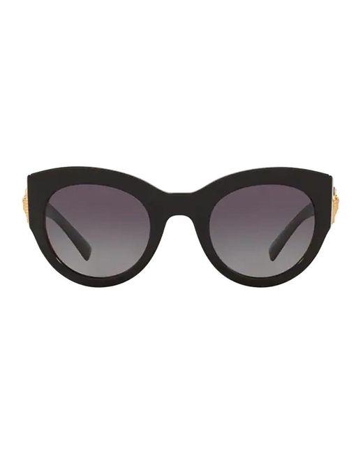 Des lunettes de soleil Versace en coloris Black