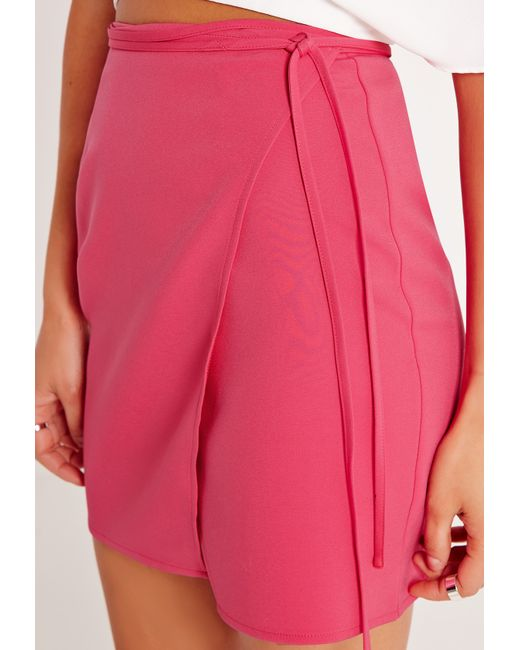missguided high waisted wrap skirt pink in pink lyst