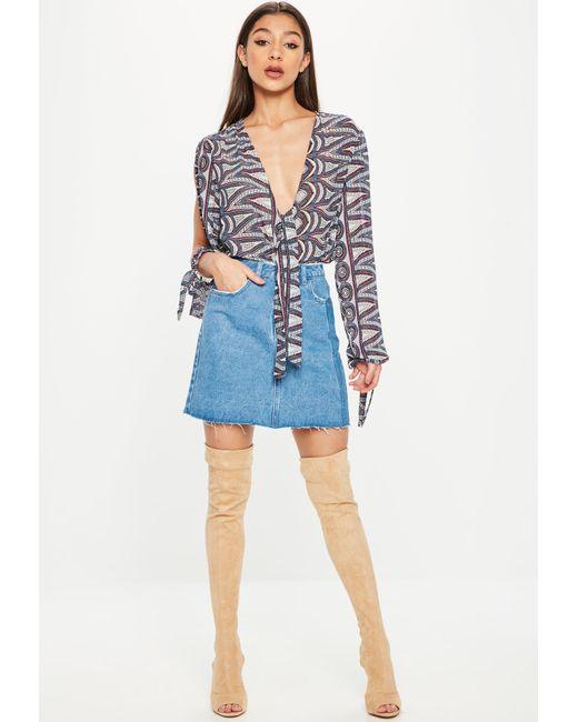... Missguided - Blue Split Sleeve Tie Bodysuit - Lyst ... 7ed7dd51d