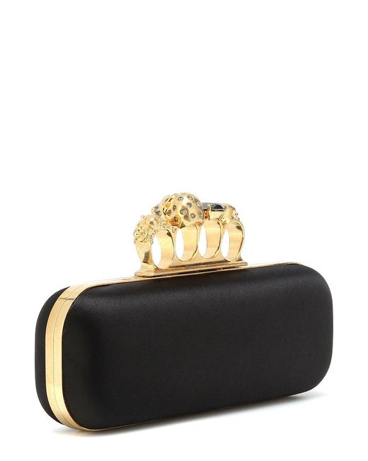 Clutch in raso con cristalli di Alexander McQueen in Black