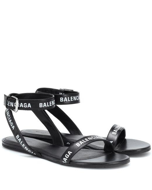 d31ab76a261e9 Lyst - Balenciaga Black Logo Strappy Flat Sandals in Black - Save 1%