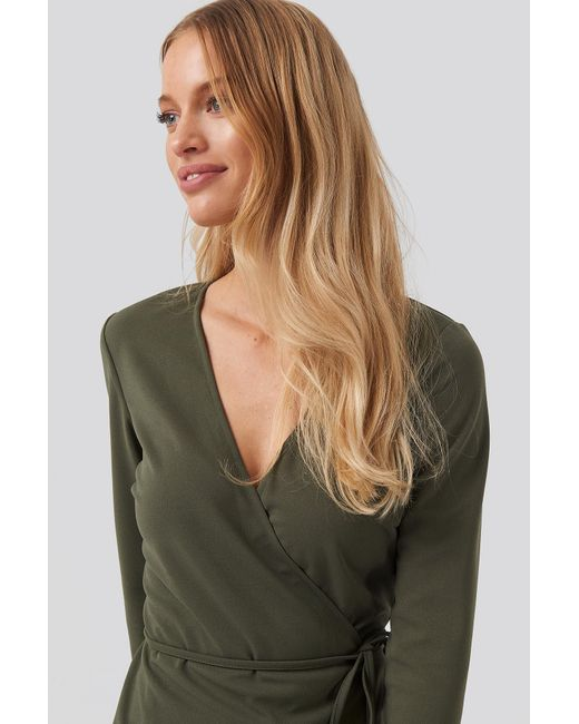 Wrap Over Long Sleeve Top NA-KD en coloris Green