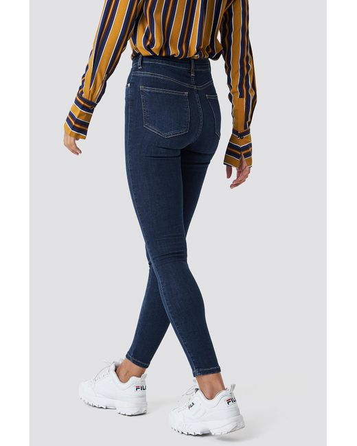 NA-KD Skinny High Waist Button Zipper Jeans femme de coloris bleu