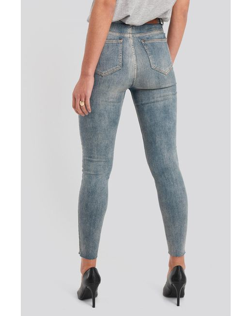 NA-KD Skinny High Waist Raw Hem Jeans in het Blue