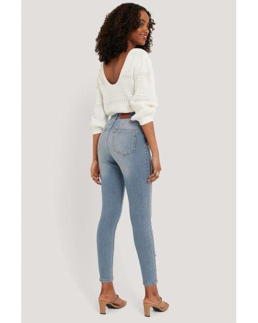 NA-KD Blue Chewed Hem Skinny Cropped Jeans