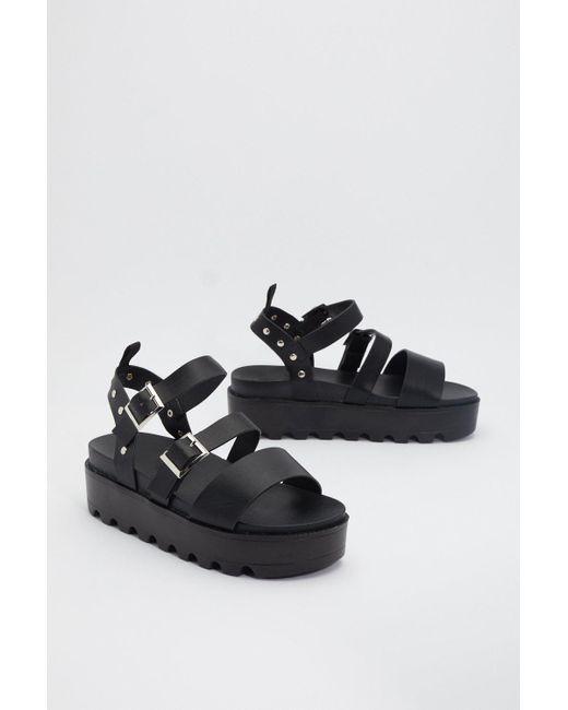 black cleated platform sandals