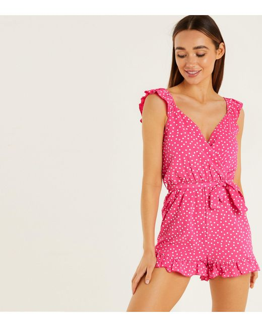 Quiz Pink Polka Dot Ruffle Wrap Playsuit