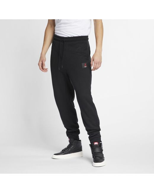 e03d8e38a25a53 Nike - Black Jordan Flight Trousers for Men - Lyst ...