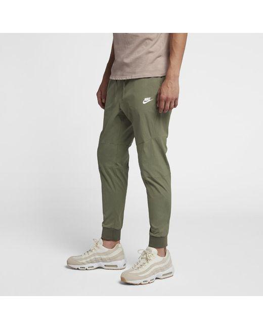 846fc436a21 Lyst - Nike Sportswear Tech Men s Woven Joggers in Green for Men