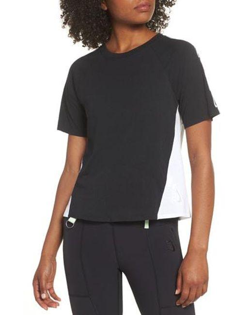 15a0010e7 Nike Nrg Women's Dri-fit Short Sleeve Top in Black - Lyst