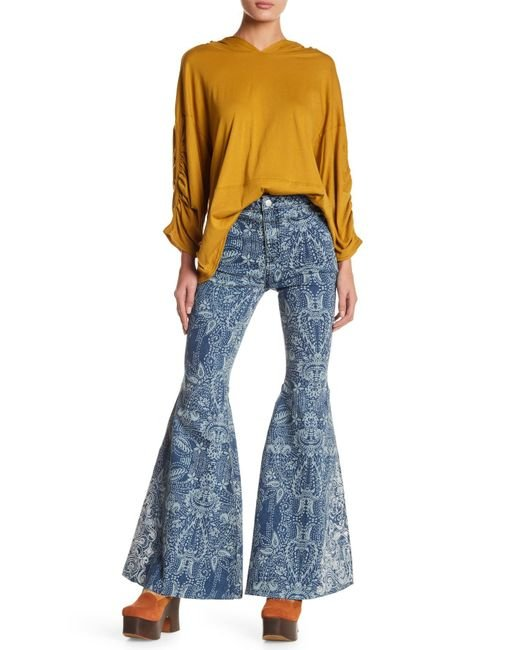 Free people embroidered bell bottom jeans in blue lyst