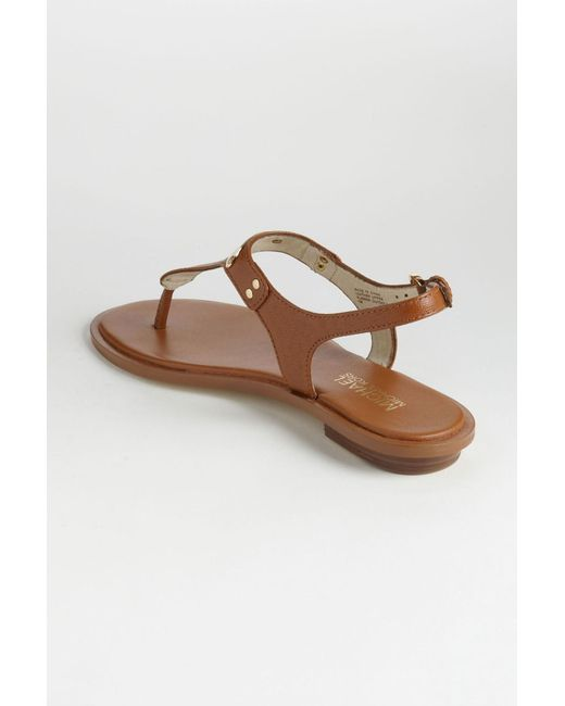 5d631804649f ... MICHAEL Michael Kors - Brown Mk Plate Thong (navy Saffiano 1) Women s  Sandals ...